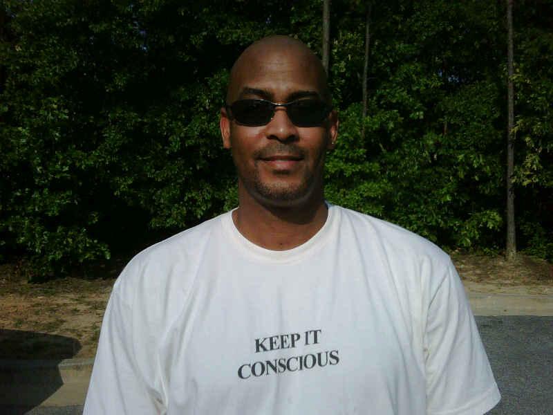 Best selling author, Nkansa Casterlow wears Inpeloto\'s Keep It Conscience tshirt